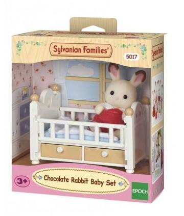 Bébé lapin chocolat et le lit